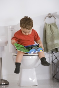 boy-reading-book-on-potty